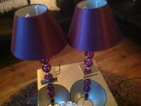 A PAIR OF PURPLE LAMPS