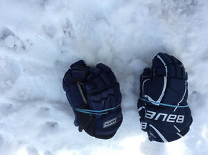 Blue and new hockey gloves
