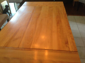 Solid maple dining table with 4chairs and 1 arm chair and match.