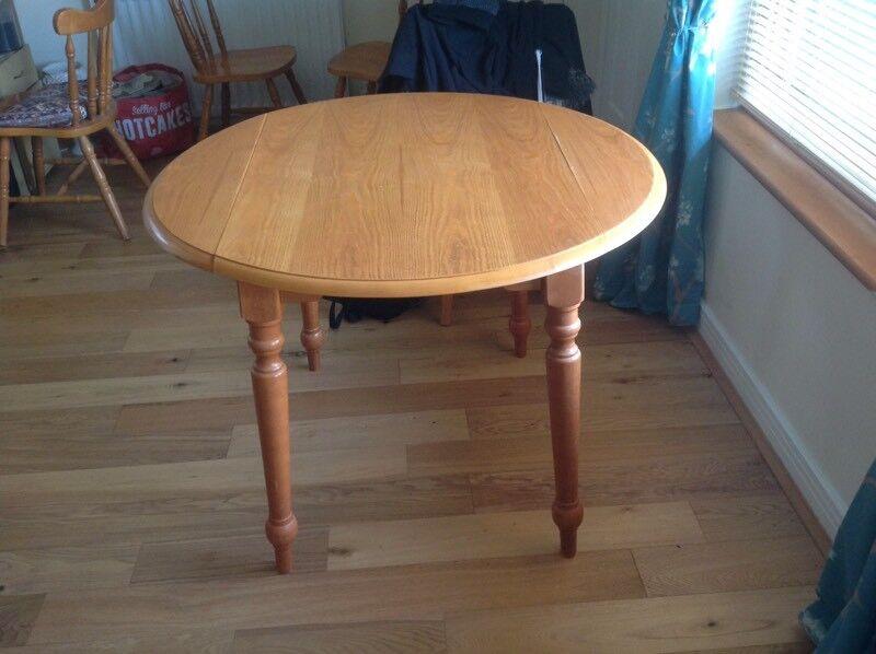 Oak veneer round kitchen table for sale