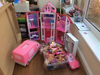 Barbie house with dolls and accessories