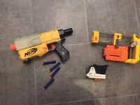 Nerf gun with attachment and 4 darts