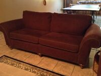 Two Wine Coloured Couches