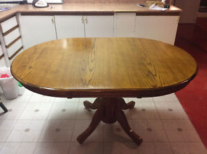 New price solid oval kitchen/diningroom pedestal  table.