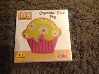 Girls cupcake coat peg