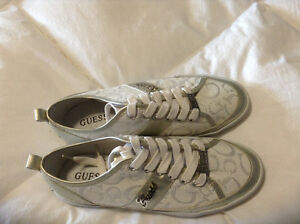 Guess running shoes for women.   Brand new. White and silver