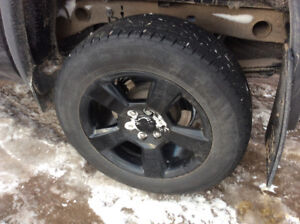 4 tires & rims from a 2018 GMC Sierra Elevation edition pickup