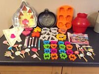 Selection of cake moulds, cutters and cake accessories