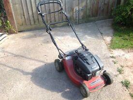 Self propelled petrol mower