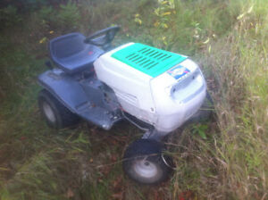 Selling white lawn tractor