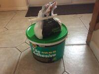 Large tub of tile adhesive
