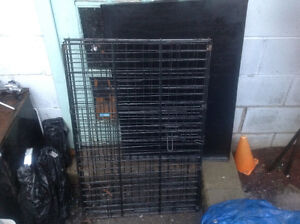 Dog cage like new ,with metal tray , only 50 dollars