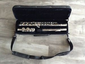 Flute with case brand name is Acadamy