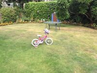 Girls pink bike with stabilisers