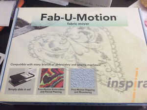 Fab-U-Motion fabric mover for easy quilting