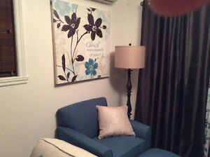 turquoise chair and ottoman