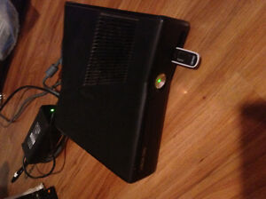 Xbox360 and 2 controllers and games
