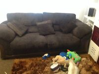 Large brown corded sofas