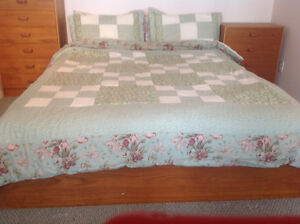 Queen size bed cover with pillow shams.