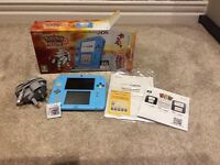 Nintendo 2ds + Pokemon sun and Mario Part Game
