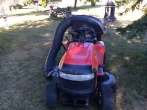 "16.5 HP Poulan XT Riding Lawnmower. 42"" with double bagger"