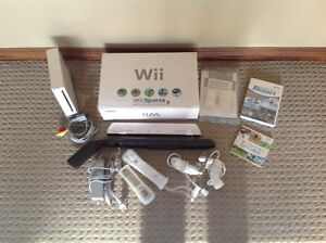 Wii Sports with Wii Sport & Sport Resort Game and Assesories.