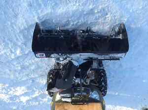 Snowblower attaches to ATV or UTV