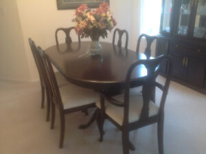 Formal dining table and cabinet with hutch