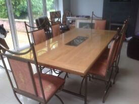 Natural Wood (Light) Dining Room Table With Six Metal/Red Chairs