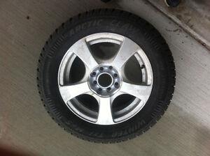 nearly brand new 4 winter tires with aluminium rims