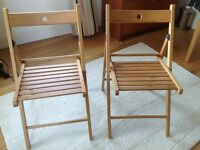 Two ikea foldable wooden chairs