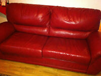 red leather couch/ pull out sofa, mattress included, mint cond
