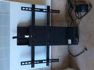 Remote control lift for tv