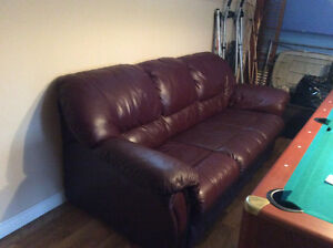 100% leather sofa and matching recliner chair
