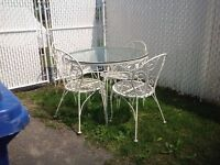 Patio/garden table with 4 chairs and glass top