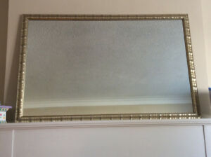 Light gold coloured framed mirror