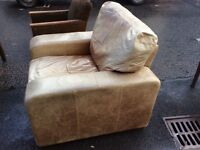 Large rustic tan leather armchair