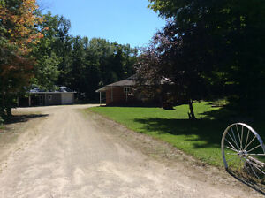 Spacious Backsplit Country Home with 100 Acres of Mature Bush