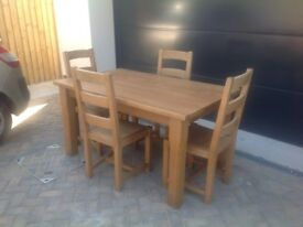 Solid oak dining table and 4chairs