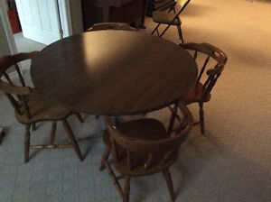 round dinette table and 4 chairs