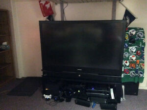 """Used Samsung 67"""" DLP TV with stand"""