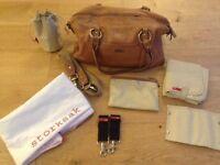 Storksak tan leather change bag