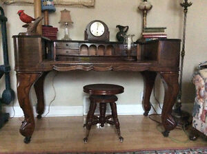 Antique grand piano converted into a desk plus other antiques!