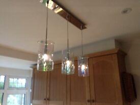 Three light pendant. Translucent shades. On chrome bar