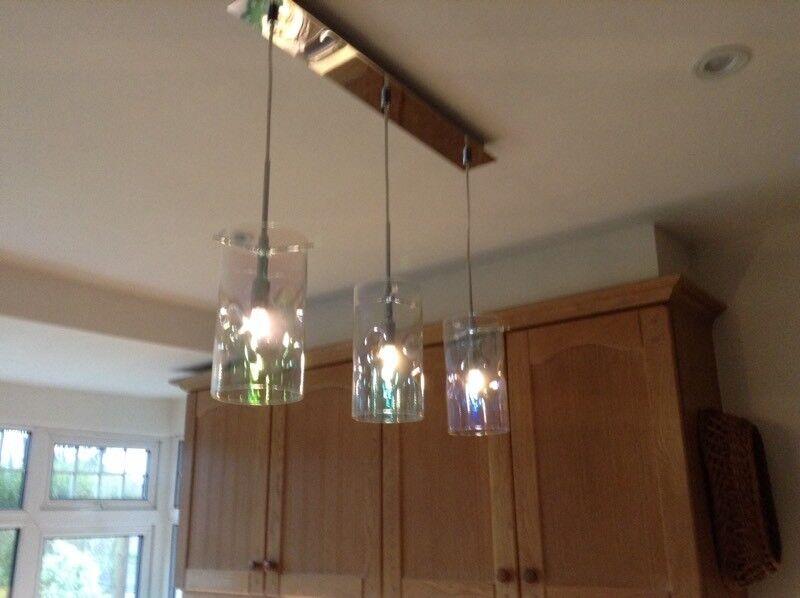 Three light pendant. Translucent shades. On chrome bar | in ...