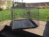 Metal dog crate for use in a car