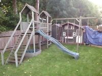 Large children's wooden climbing frame, in need of some repair.