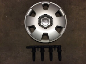 "Astra 1.8lt engine coil pack. All 4 OEM. And 16"" hub cap"