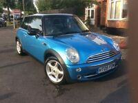 Mini Cooper 2005 3 door hatchback in metallic blue with double panoramic folding glass roof.