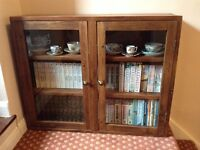 Wood cabinet, glass fronted.